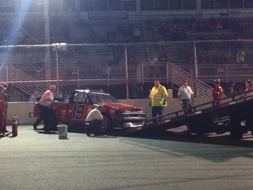 Safety crew attend to the truck & driver. Wallace walks away under his own power.
