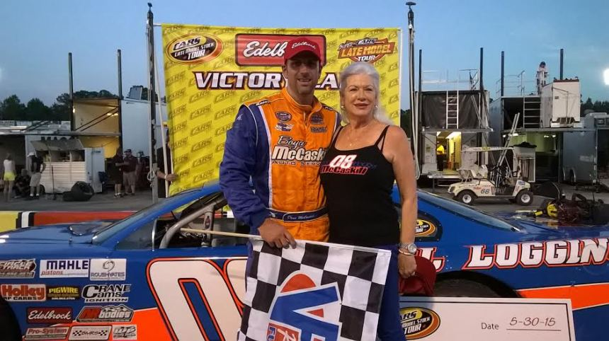Deac McCaskill (left) and his mother, Kay (right), who was recently diagnosed with breast cancer, celebrate in victory lane after Deac's triumph in the 125-lap CARS Tour Late Model Stock Car race. (Photo credit: Andy Marquis/RACE22.com for Southern National Motorsports Park)