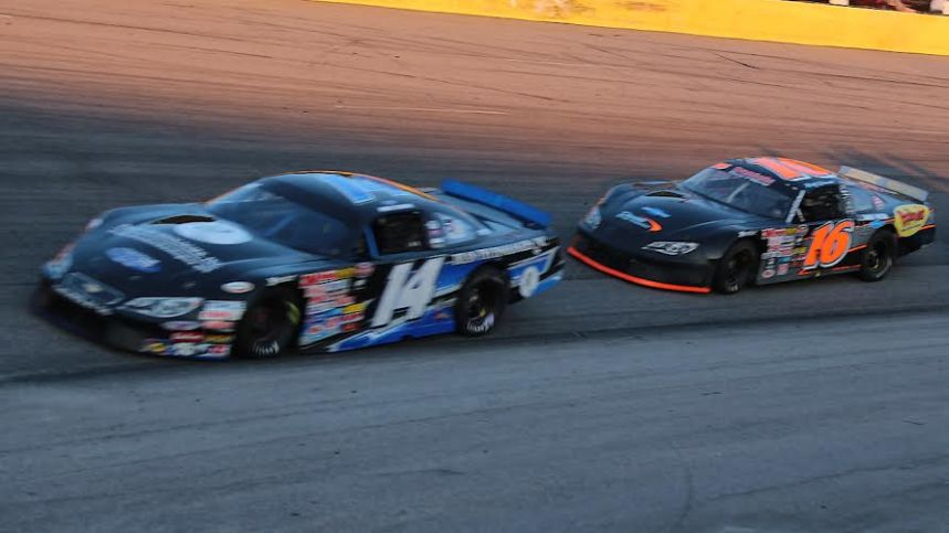 Mike Darne (14) leads Rusty Daniels (16) in the first of two Late Model races at Southern National Motorsports Park on Saturday night, August 1st.  Both drivers scored victories. (Photo credit: Alicia Hackett/Frameworks Photography)
