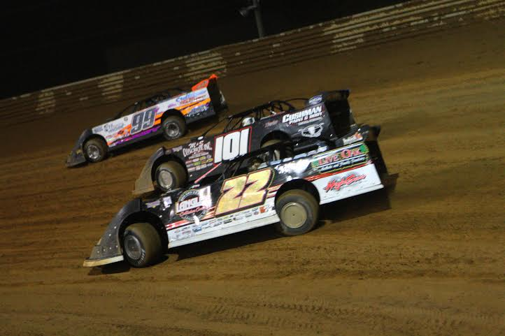 (Al Goulder photo credit): ferguson_roberts_hardy.jpg – 2014 USA 100 winner Chris Ferguson (22) battles three wide with 3-time and defending Ultimate Super Late Model Series Champion Casey Robert (101) and Kyle Hardy (99) during last year's 39th Annual USA 100 at Bill Sawyers Virginia Motor Speedway.