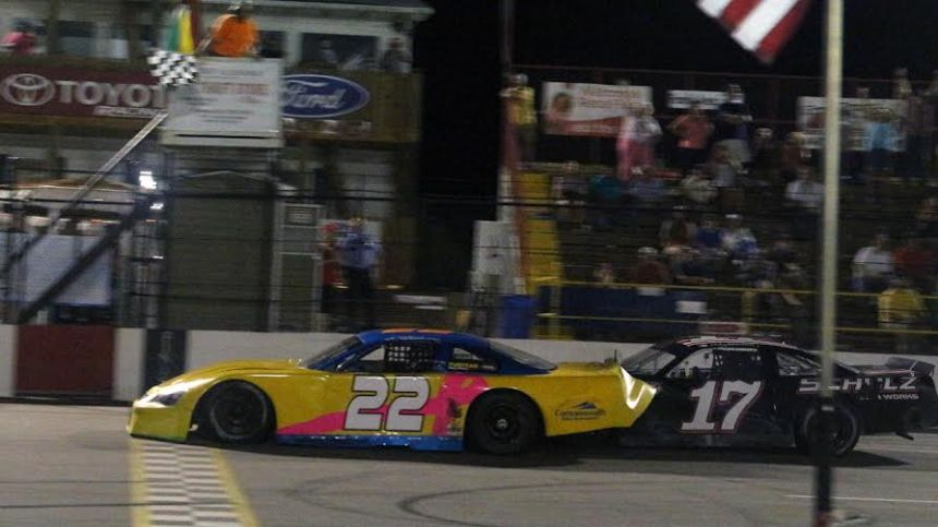 Eric Winslow (22) beats Zachary Marks (17) to the line in a thrilling finish at Carteret County Speedway. (Photo credit: Alicia Hackett/Frameworks Photography)