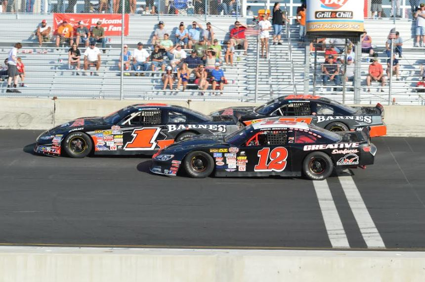 Trent Barnes (middle) Nick Smith (bottom) and Doug Barnes, Jr. (top) battle three wide for position this past Sunday afternoon at Dominion Raceway. (Charlie Alexander/King Charles Photography)