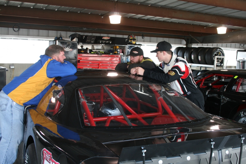 Michael Diaz (left), Tommy Lemons, Jr. (center), Mason Diaz (right) hanging out in the garage stall right at the lunch break during Thursday's test session. (Justin Kern/TheWeeklyRacer.com)