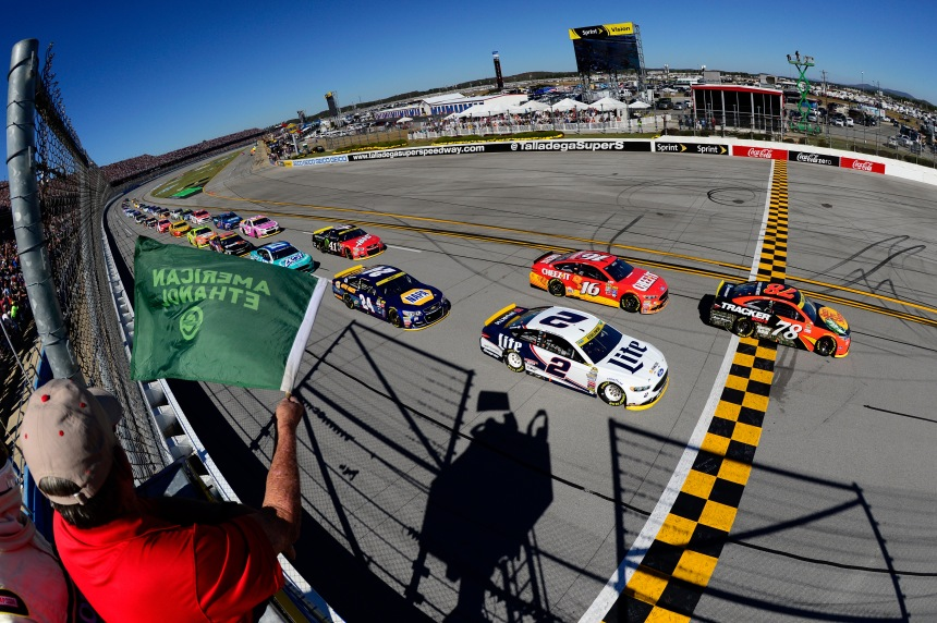 TALLADEGA, AL - OCTOBER 23:  Martin Truex Jr, driver of the #78 Bass Pro Shops/TRACKER Boats Toyota, leads the field pass the green flag to start the NASCAR Sprint Cup Series Hellmann's 500 at Talladega Superspeedway on October 23, 2016 in Talladega, Alabama.  (Photo by Robert Laberge/NASCAR via Getty Images)