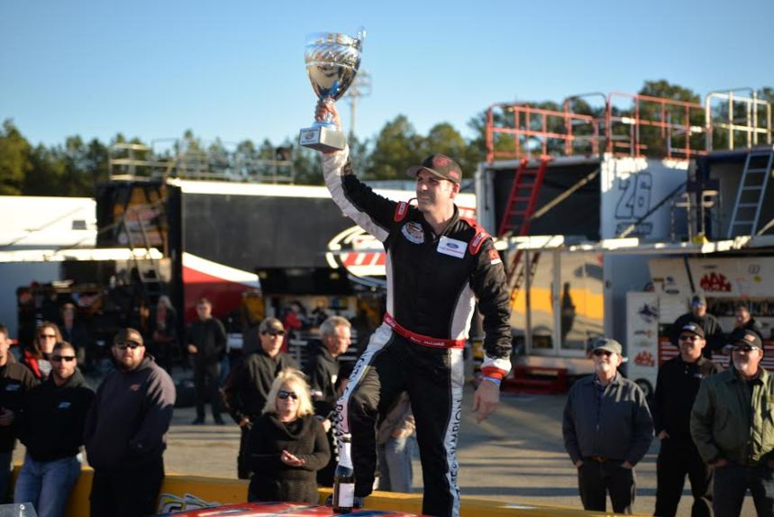 Deac McCaskill raises the CARS Late Model Stock Tour championship trophy after claiming his first series title at Southern National Motorsports Park on Saturday afternoon over Tommy Lemons and Josh Berry. (Kyle Tretow / CARS Tour)